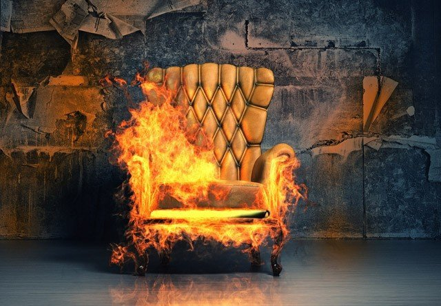 burning armchair in the grunge interior. 3D illustration creativ