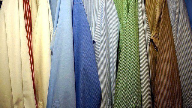 lots of shirts in a wardrobe
