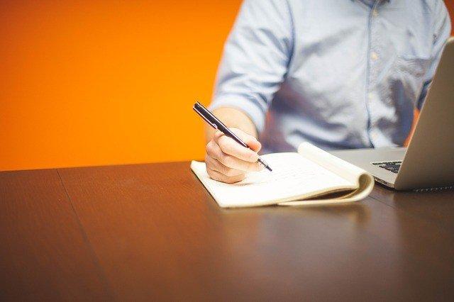 writing book pen laptop