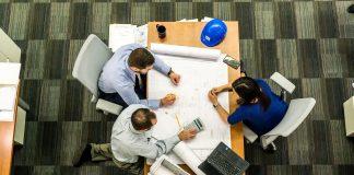 team planning work around a desk