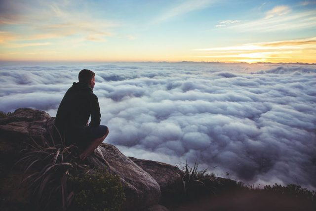 man-on-mountain-above-clouds
